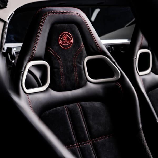 Lotus Elise sports car driver and passenger seats with harness holes