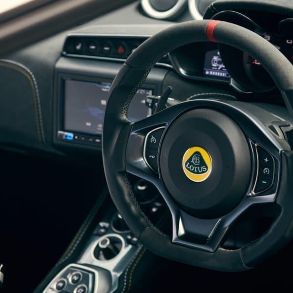 Lotus Evora steering wheel close up interior photo
