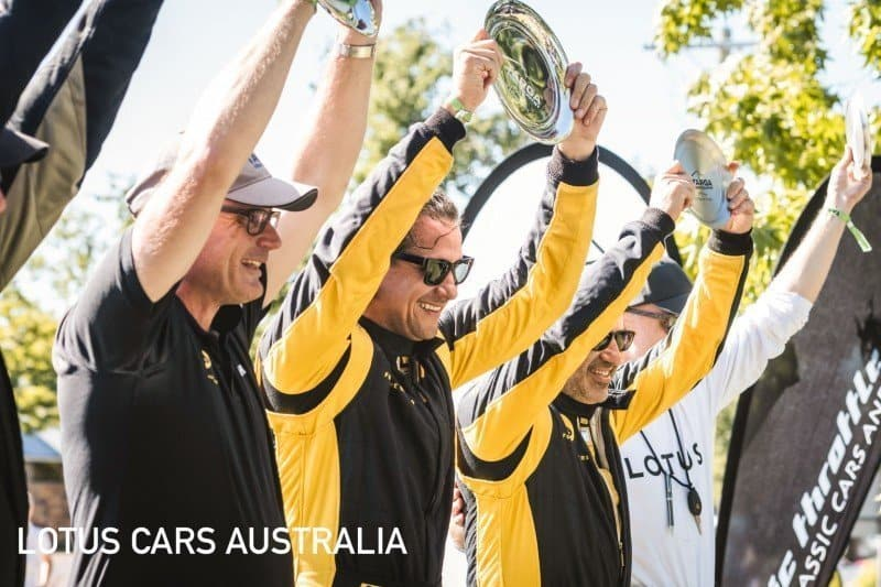 Lotus Sports Cars at Targa High Country Tarmac Rally February holding up trophy GT Sports Trophy