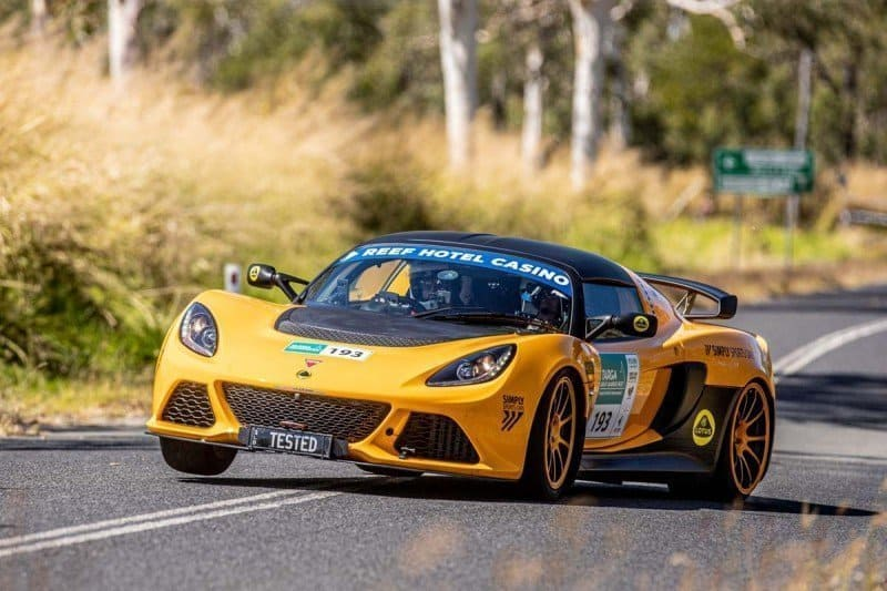 What is the best car for a Targa Rally in Australia yellow Lotus Exige sports car on the road of